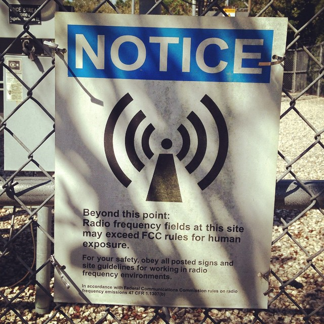 While__gifting_the_local_cell_phone_towers__found_this_sign_that_reads_Radio_Frequency_Fields_at_this_site_may_exceed_FCC_rules_for_human_exposure._This_particular_tower_was_located_between_two_homes__at_the_highest_peak_in_Florida._We_need_to_grasp_.jpg