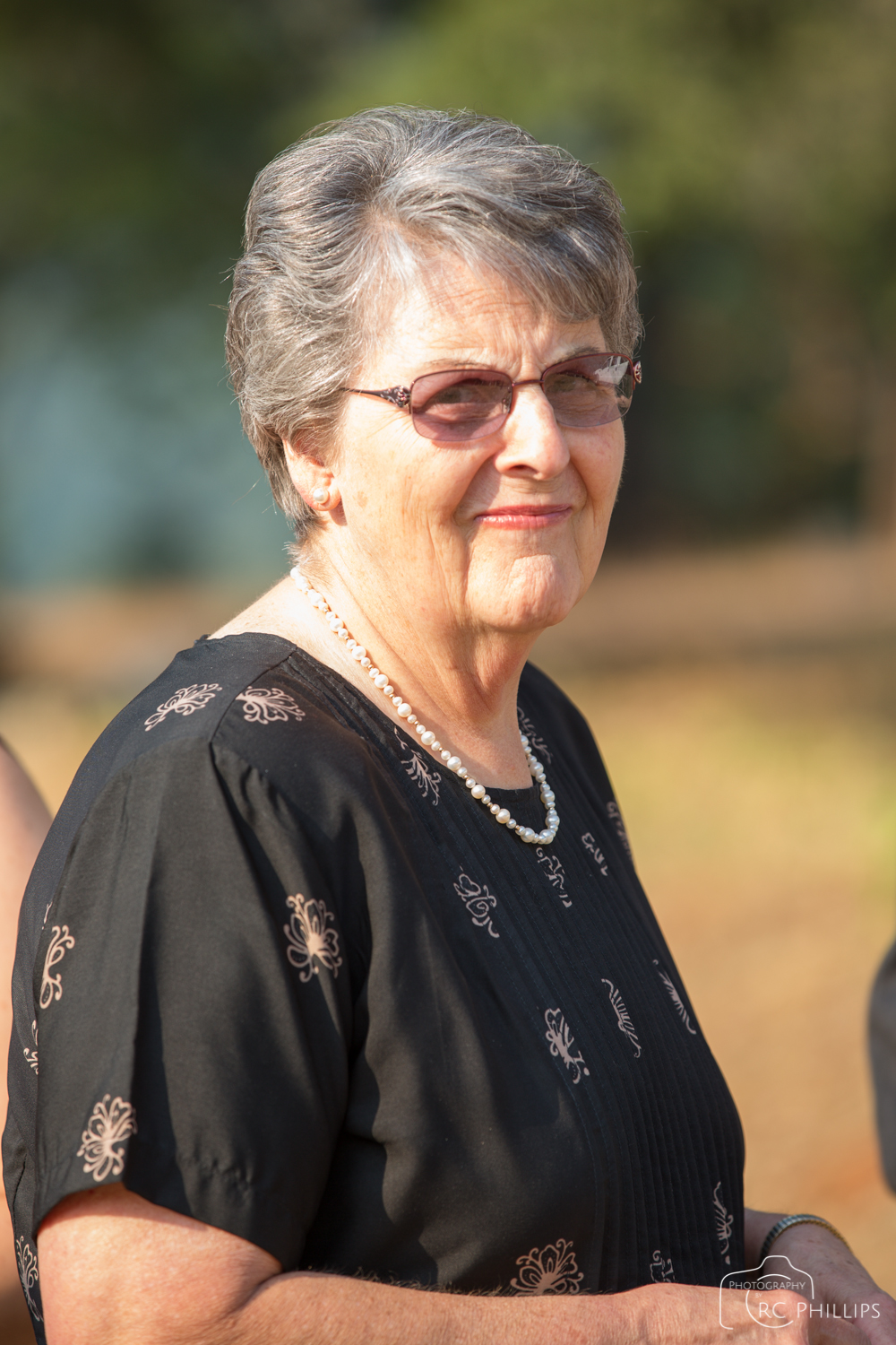 1/160 Sec. @ f/4.0 and ISO 100 Dan's mother Myrna at the graveside service.