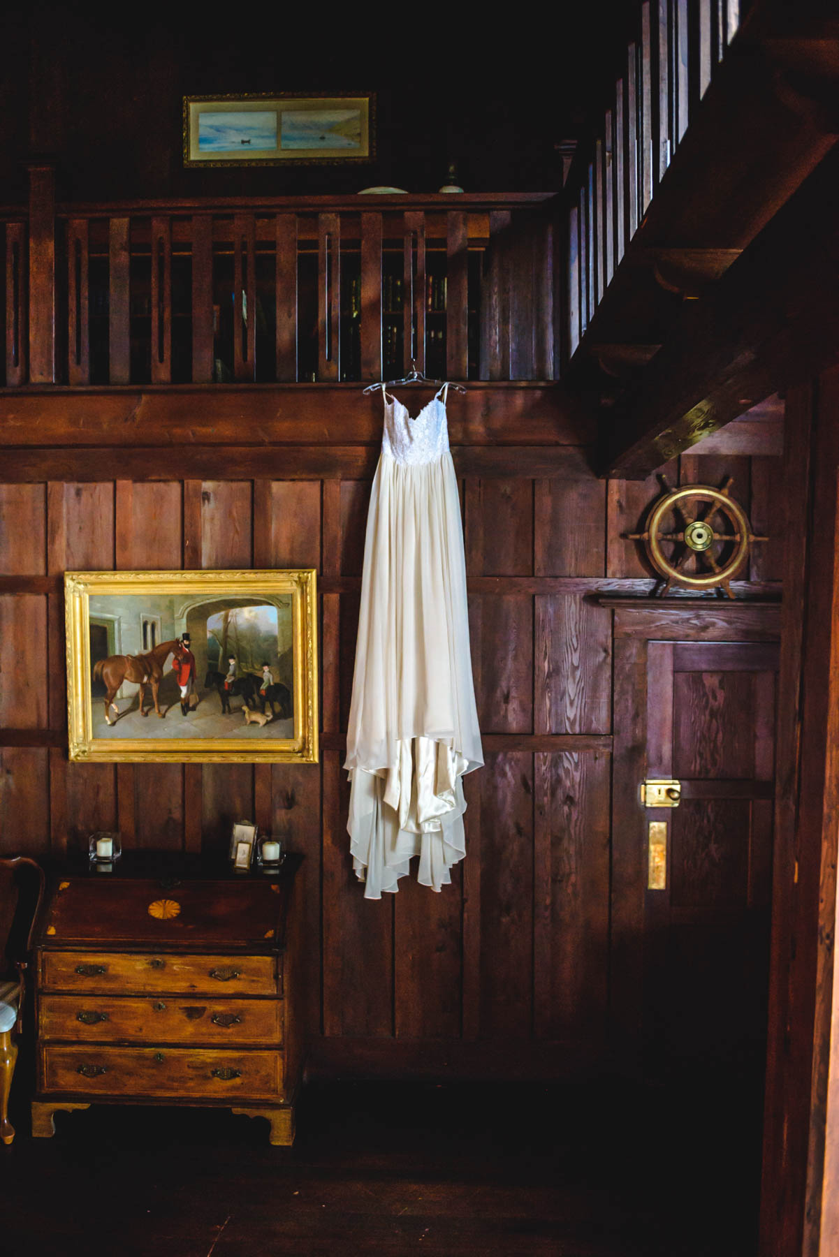 Wedding Dress Hanging from Staircase in Old Mansion