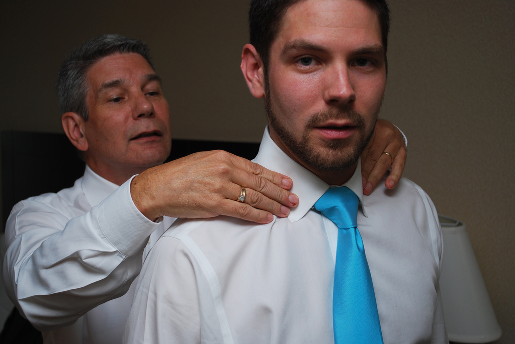 Father Helping Son Get Ready for Wedding
