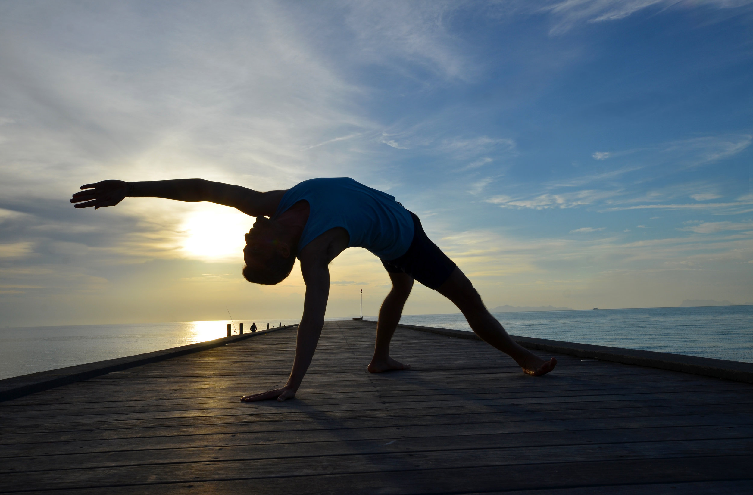 A serene blue sunset, in Koh Samui, Thailand, with Manuel de la Torre, yoga and fitness instructor at Samahita Retreat. His calm and supportive nature will help you practice in a meaningful manner. If you'd like to connect: @yogaconmanu.