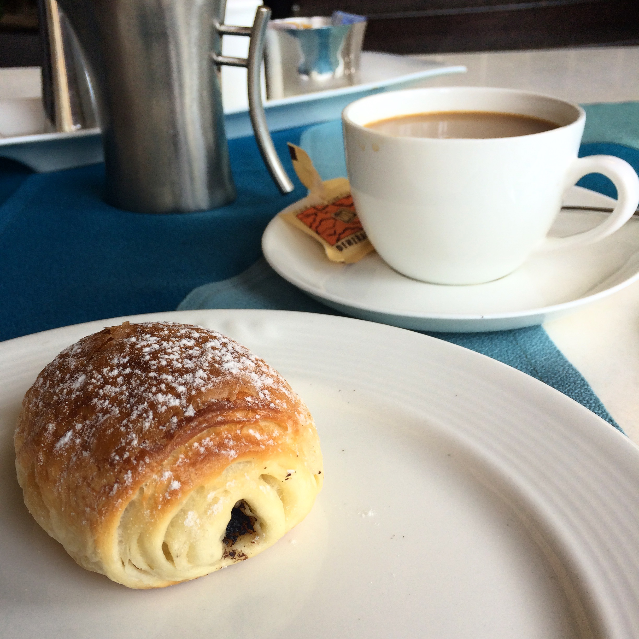 I spent one day entirely by myself -- table for one -- and enjoyed this delicious breakfast of coffee + a chocolate croissant.