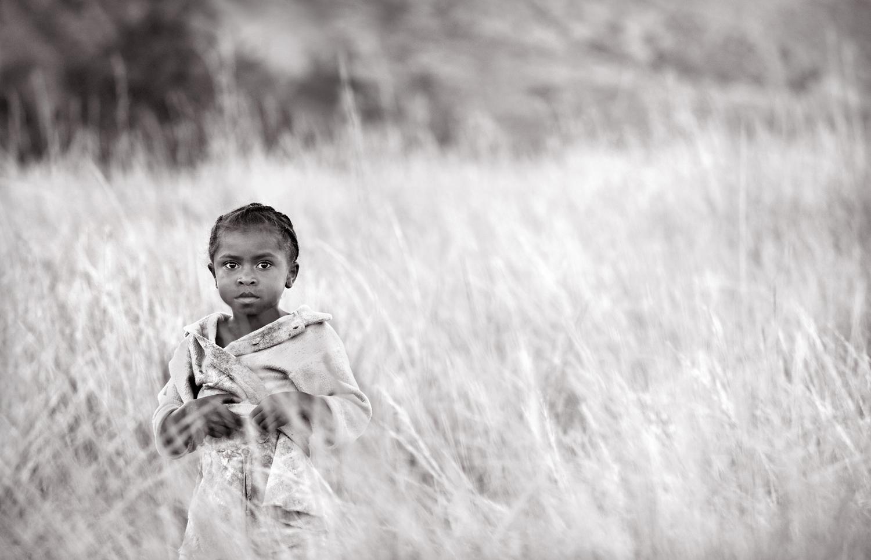 Girl In Tall Grass. Photo: Lynn Gail