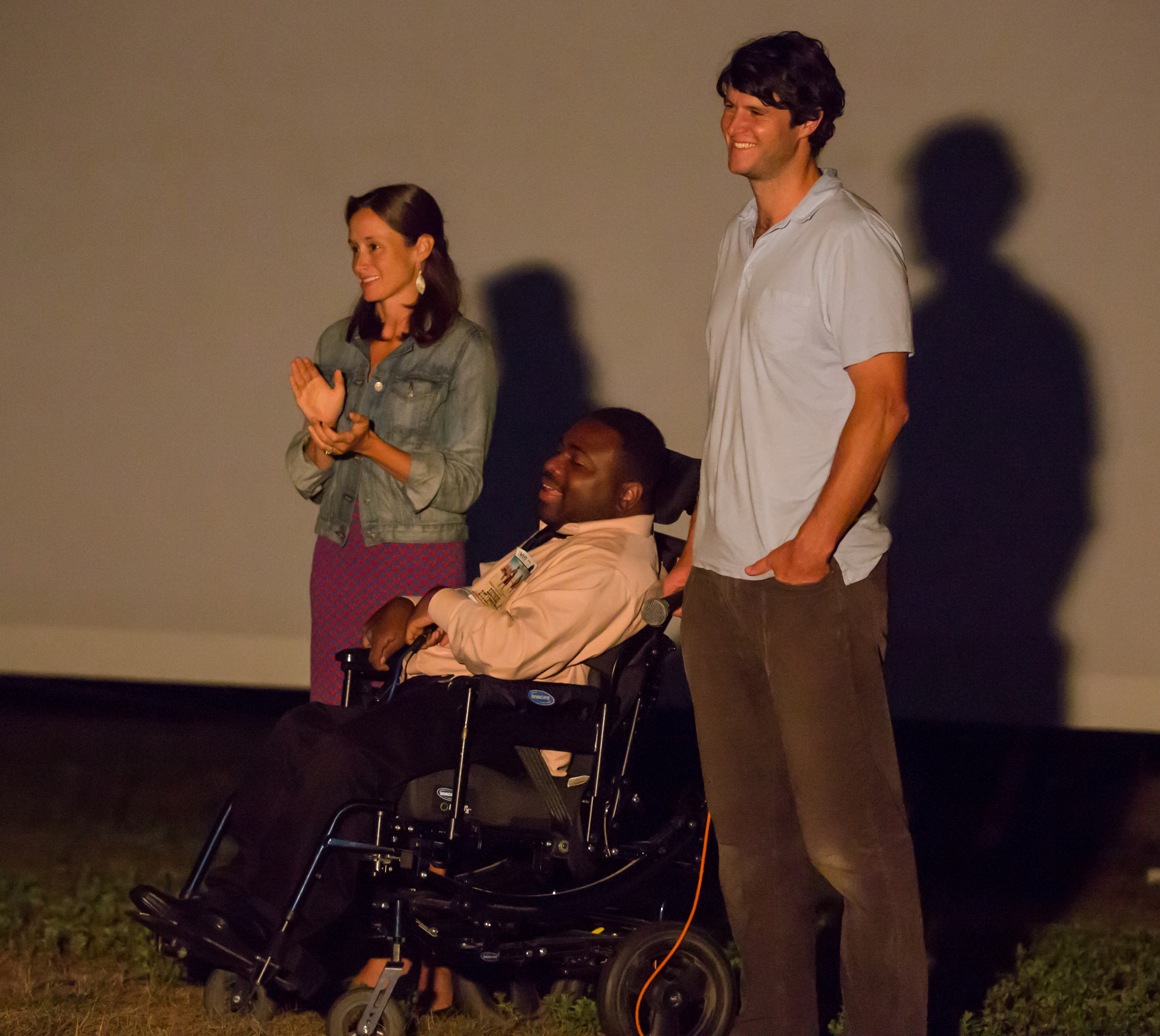 Film subjects Ila Halby, A.J. Murray, and Peter Halby receive a standing ovation after the outdoor screening of BECOMING BULLETPROOF on August 13, 2015, at Owen Park in Vineyard Haven. Photo by Maria Thibodeau.