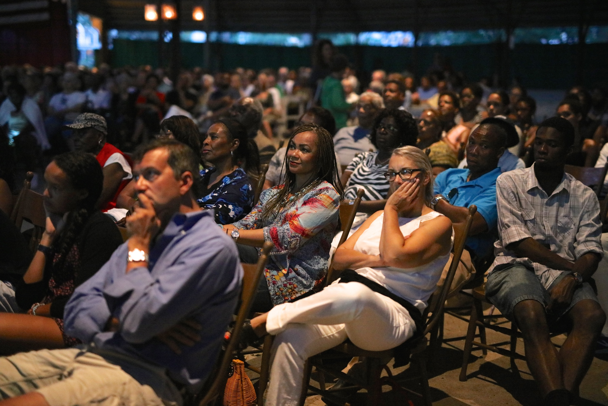 The audience listens to director Stanley Nelson, former Black Panther Kathleen Cleaver, and Professor Henry Louis Gates, Jr. speak after the screening of THE BLACK PANTHERS: VANGUARD OF THE REVOLUTION on August 3, 2015,at the Tabernacle in Oak Bluffs. Photo by Reece Robinson.
