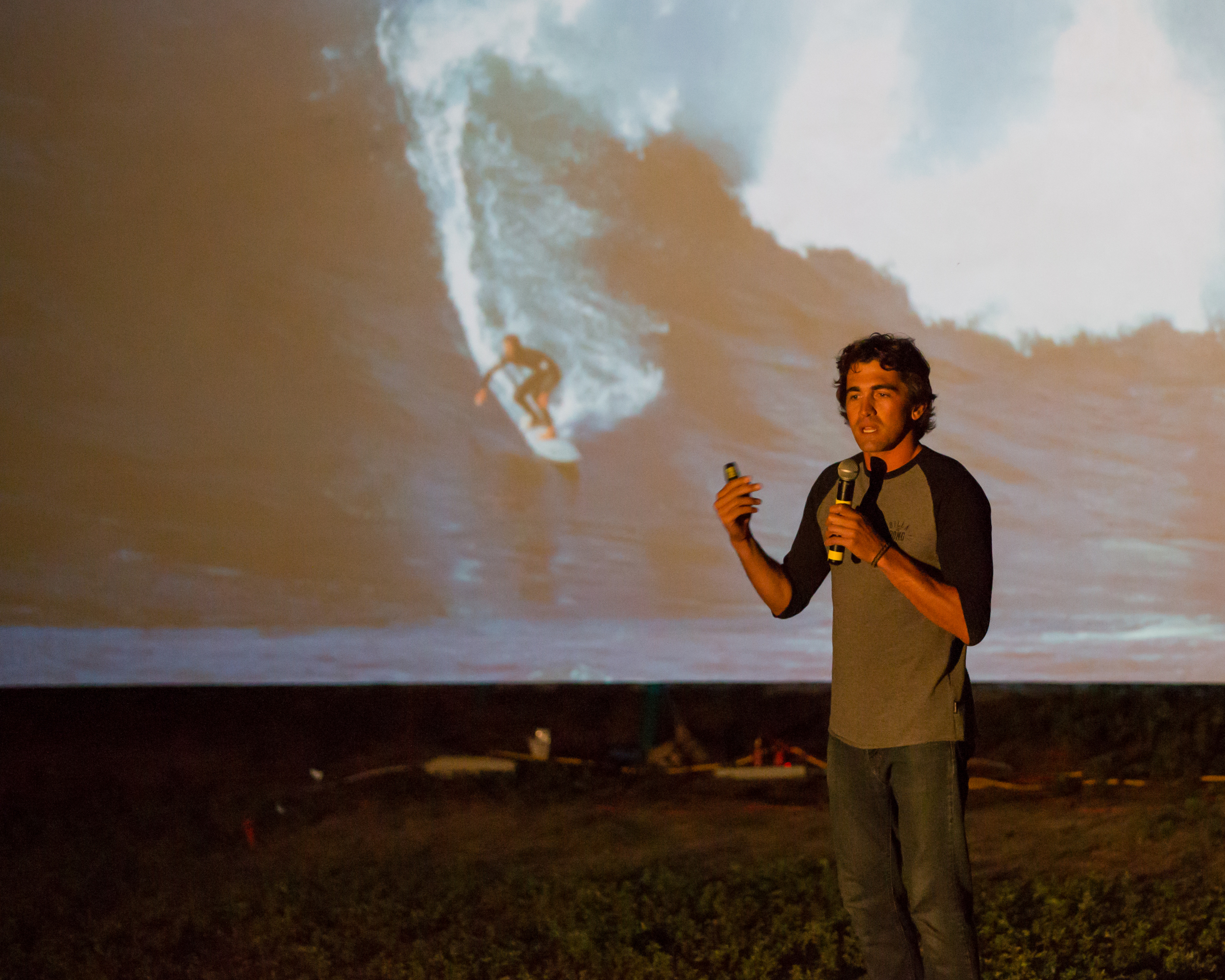 Big-wave surfer Greg Long speaking during his presentation at the MVFF's second annual SURF NIGHT on August 6, 2015,at Owen Park in Vineyard Haven. Photo by Maria Thibodeau.