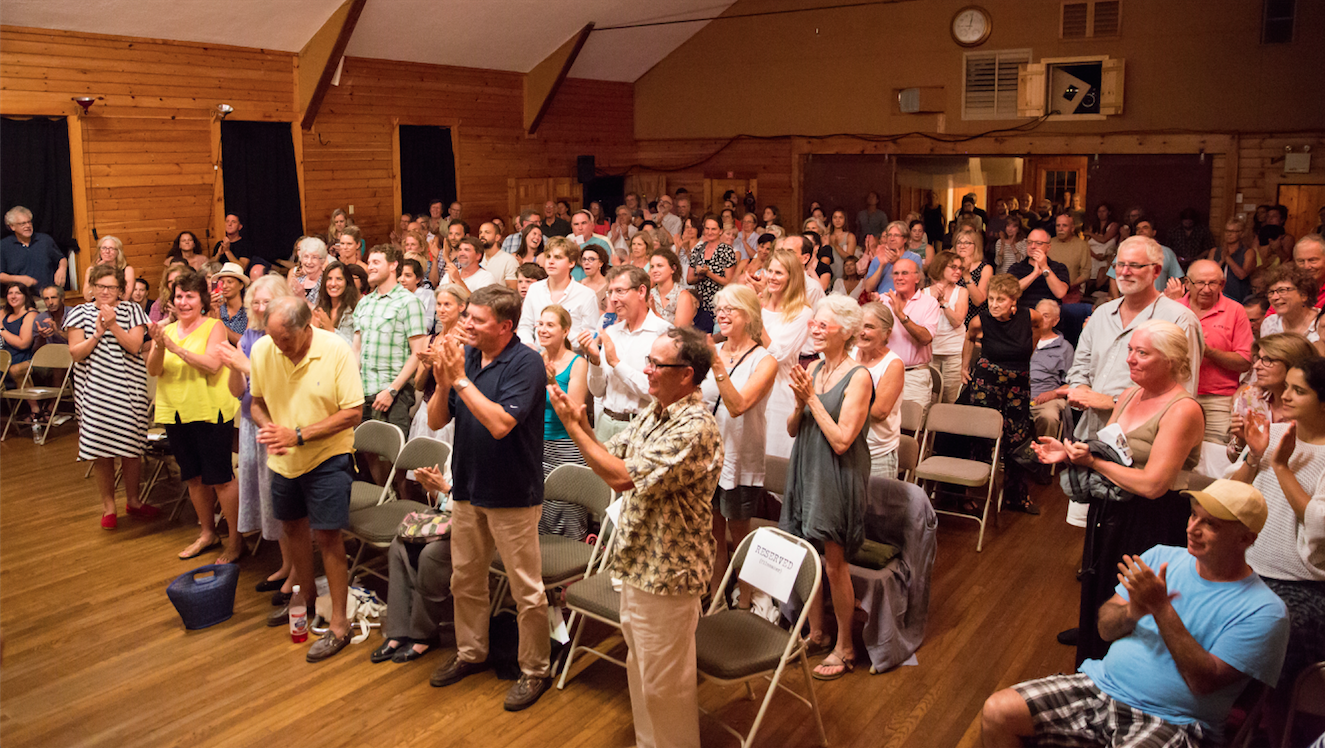 A standing ovation welcomes musician Seymour Bernstein to the stage for a Q&A following the screening of SEYMOUR: AN INTRODUCTION on July 29, 2015. Photo by Maria Thibodeau.