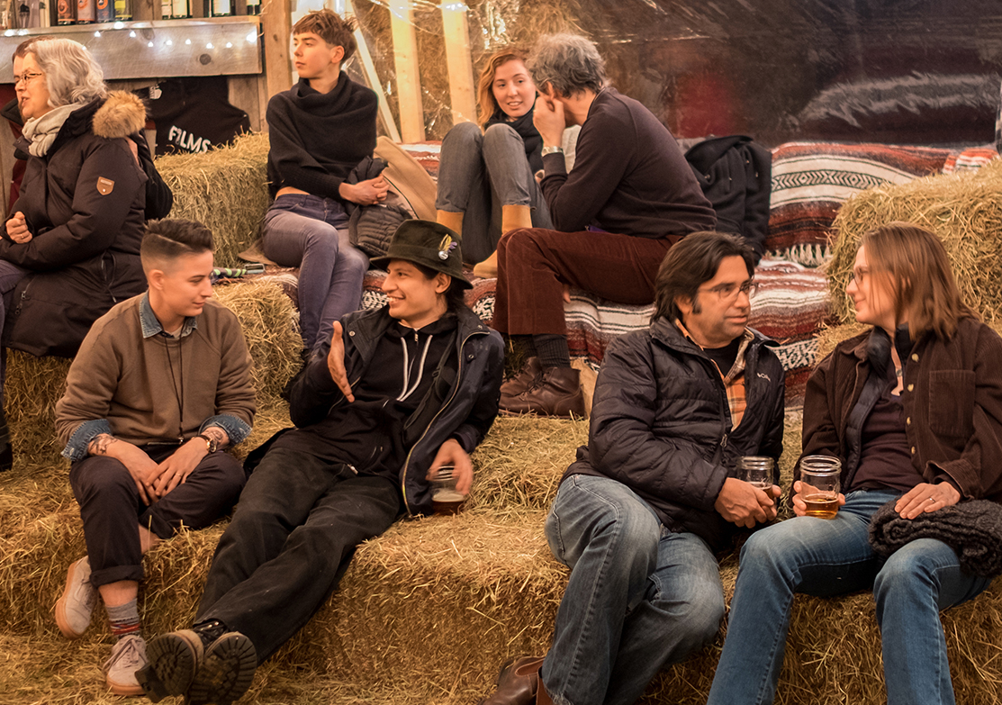 At our festival in March, you'll gather on couches and hay bales and experience the magic of our community.