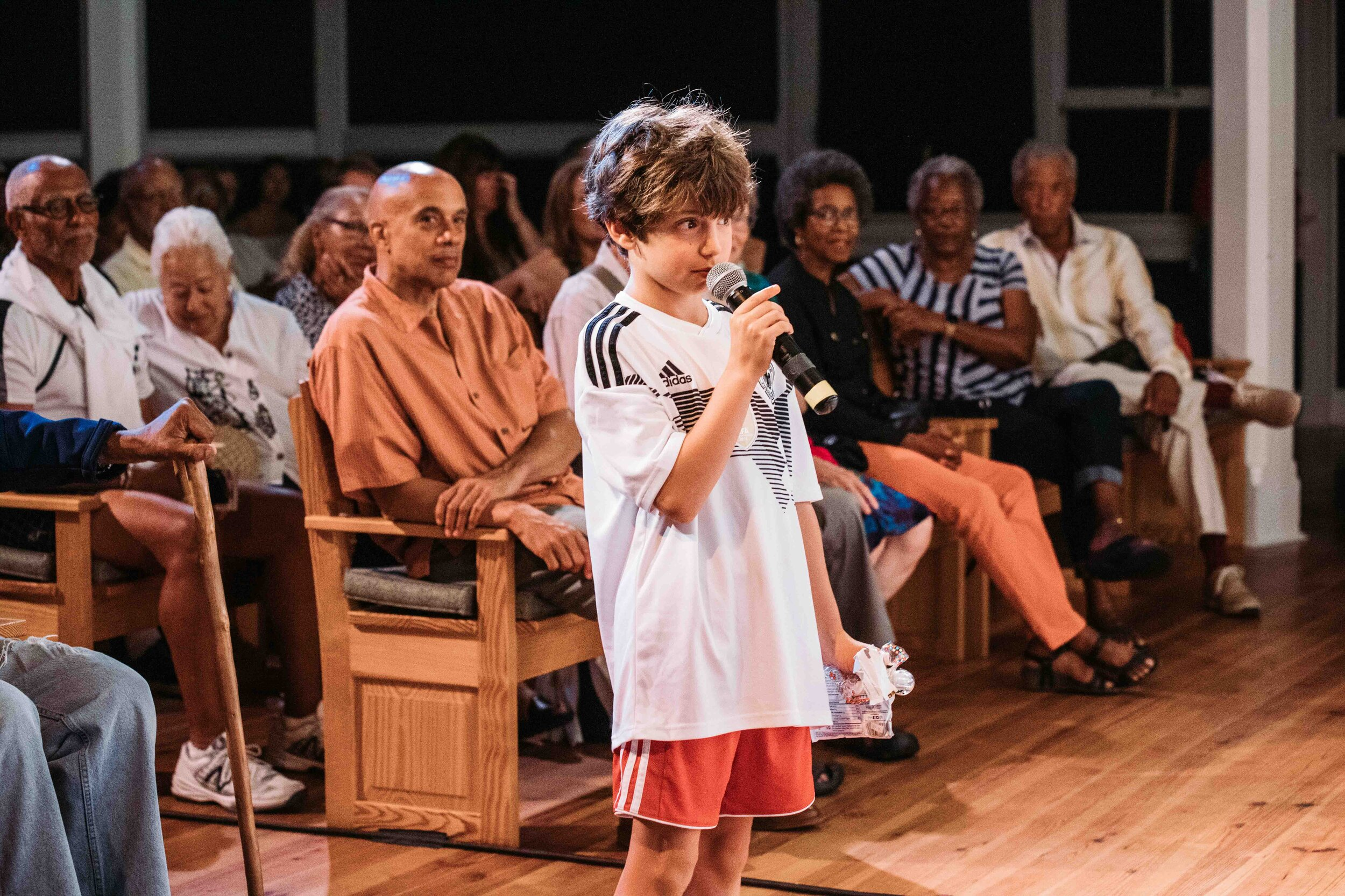 A young filmgoer asks a question during a post-film discussion. Photo by Reece Robinson.