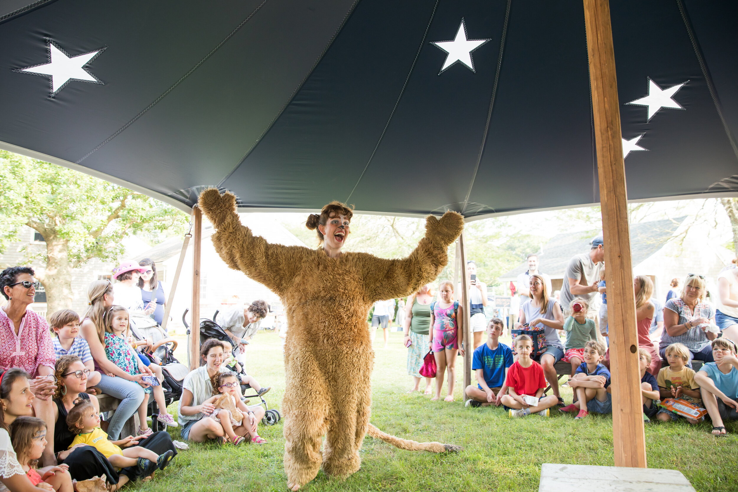 Leslie the Lion performs in a show under the Big Top at a free Cinema Circus. Photo by Maria Thibodeau.