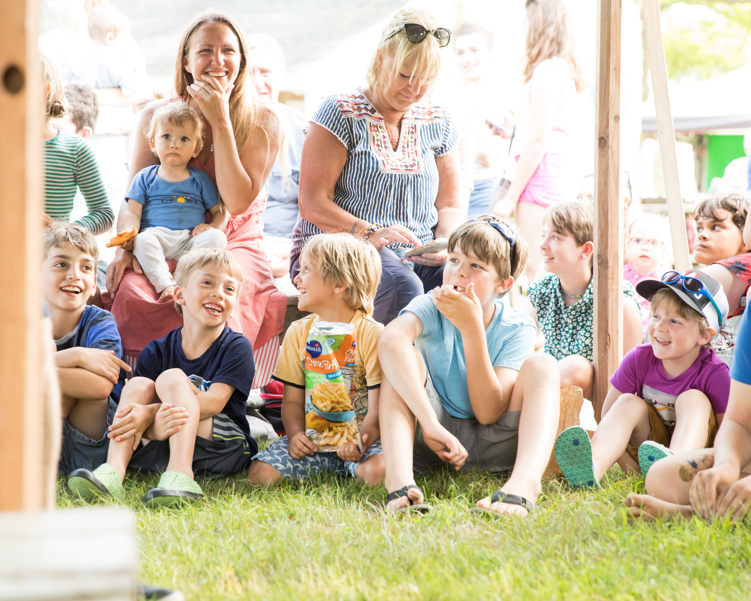 Families gather under the Big Top at a free Cinema Circus. Photo by Maria Thibodeau.