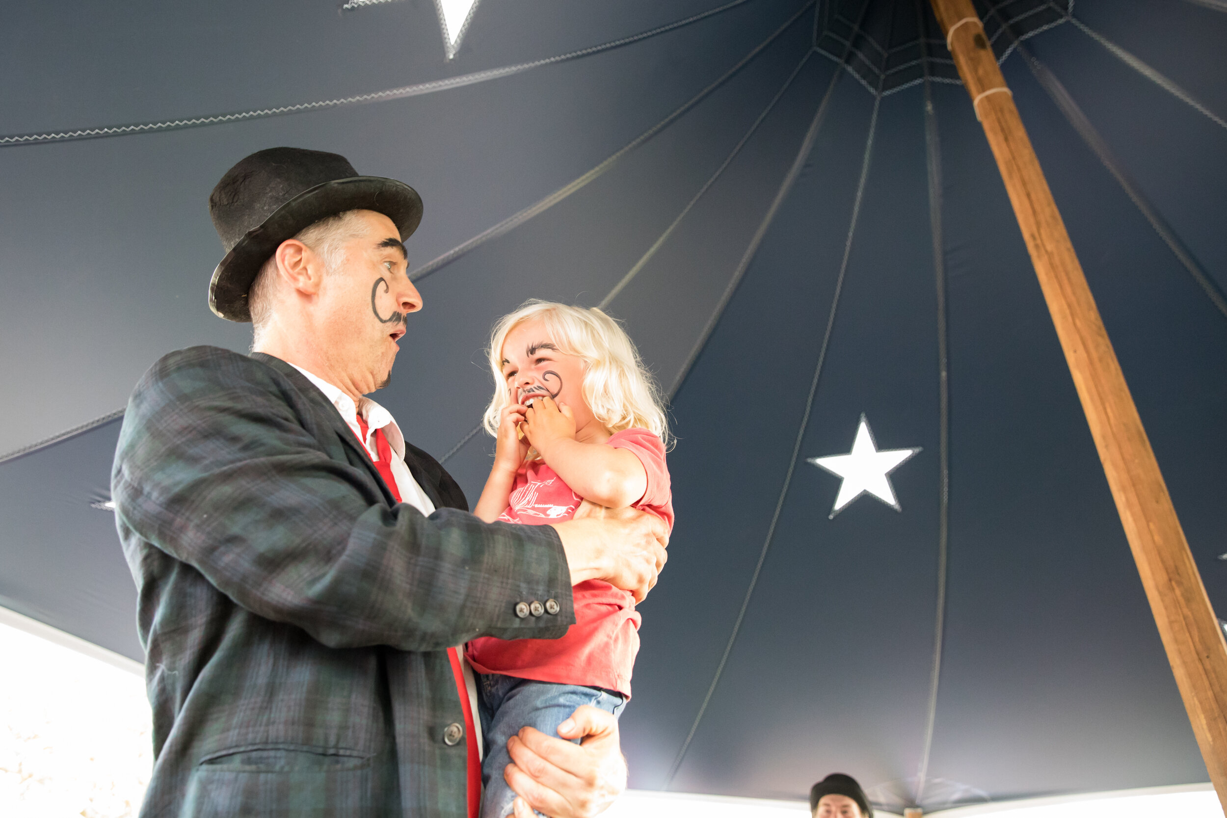 Scott Barrow performs in a show under the Big Top at a free Cinema Circus. Photo by Maria Thibodeau.