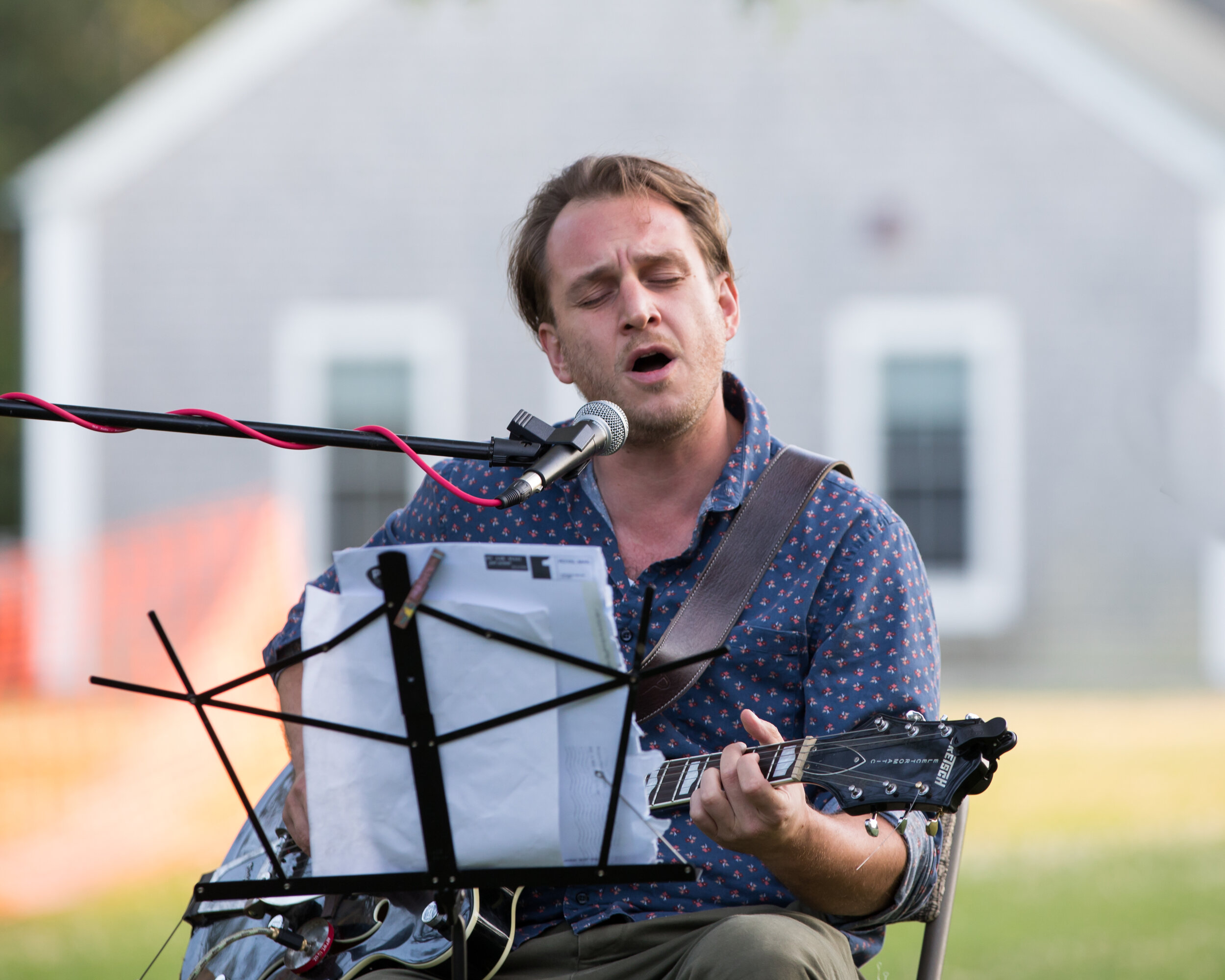 Willy Mason performs on the lawn of the Chilmark Community Center before MARIANNE & LEONARD. Photo by Maria Thibodeau.