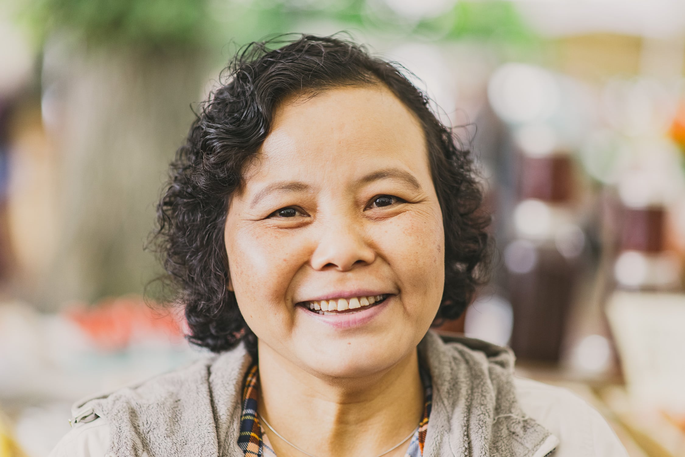 Portrait of Tee Mu, a refugee from Burma who spent over 20 years in a Thai refugee camp before moving to Portland. Now she participates in the gardening program through  Mercy Corps Northwest .