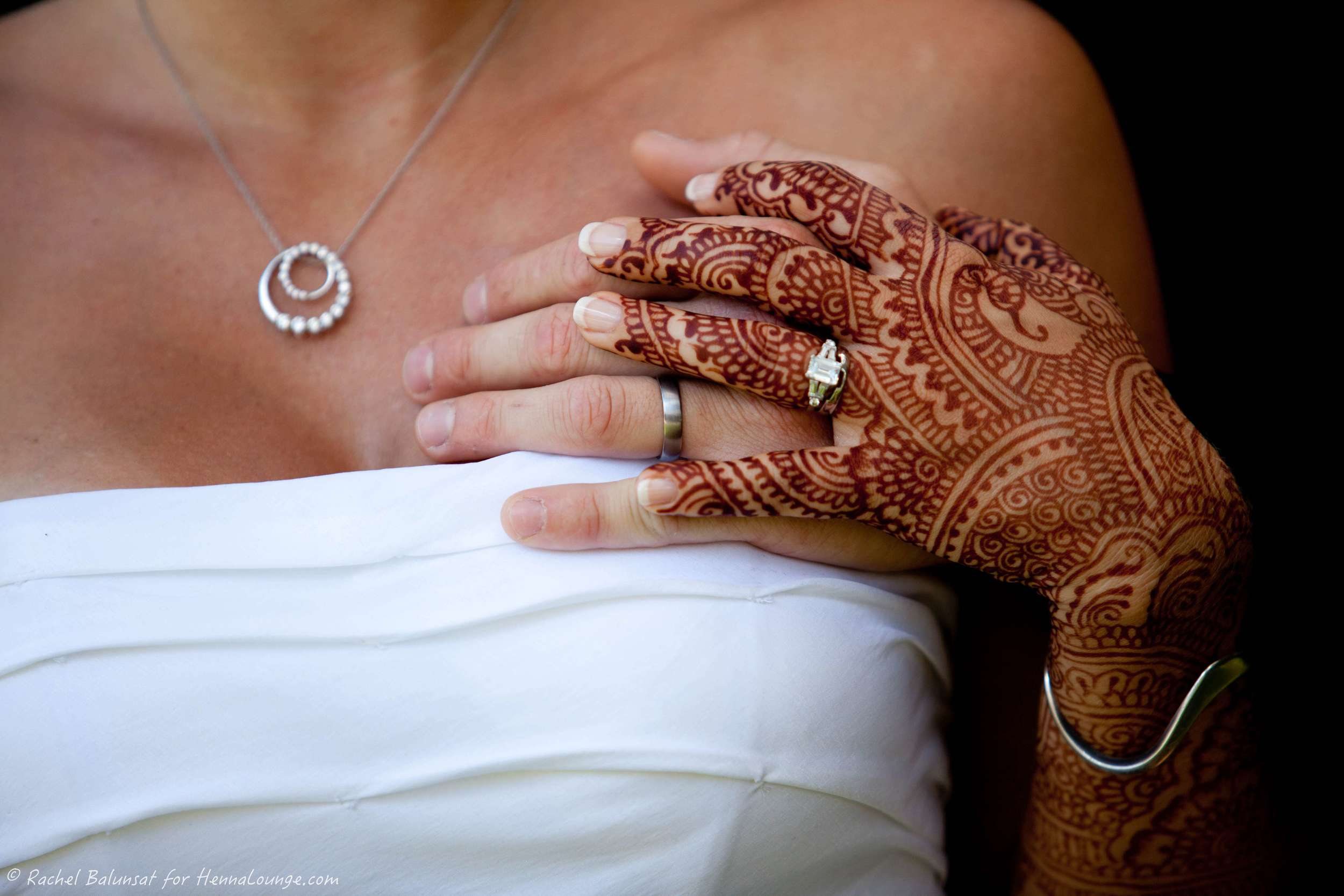 The rich color of her mehndi is a great backdrop for the sparkler on her finger. Photo by Rachel Balunsat and henna by http://www.hennalounge.com
