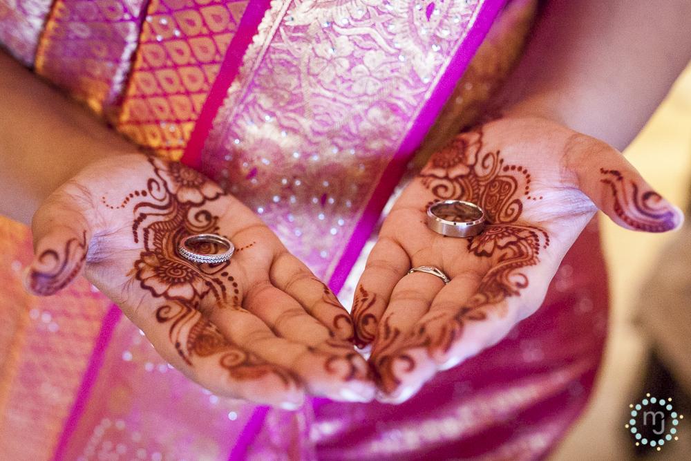 The bride's simple mehndi, glorious colorful sari and precious metals.