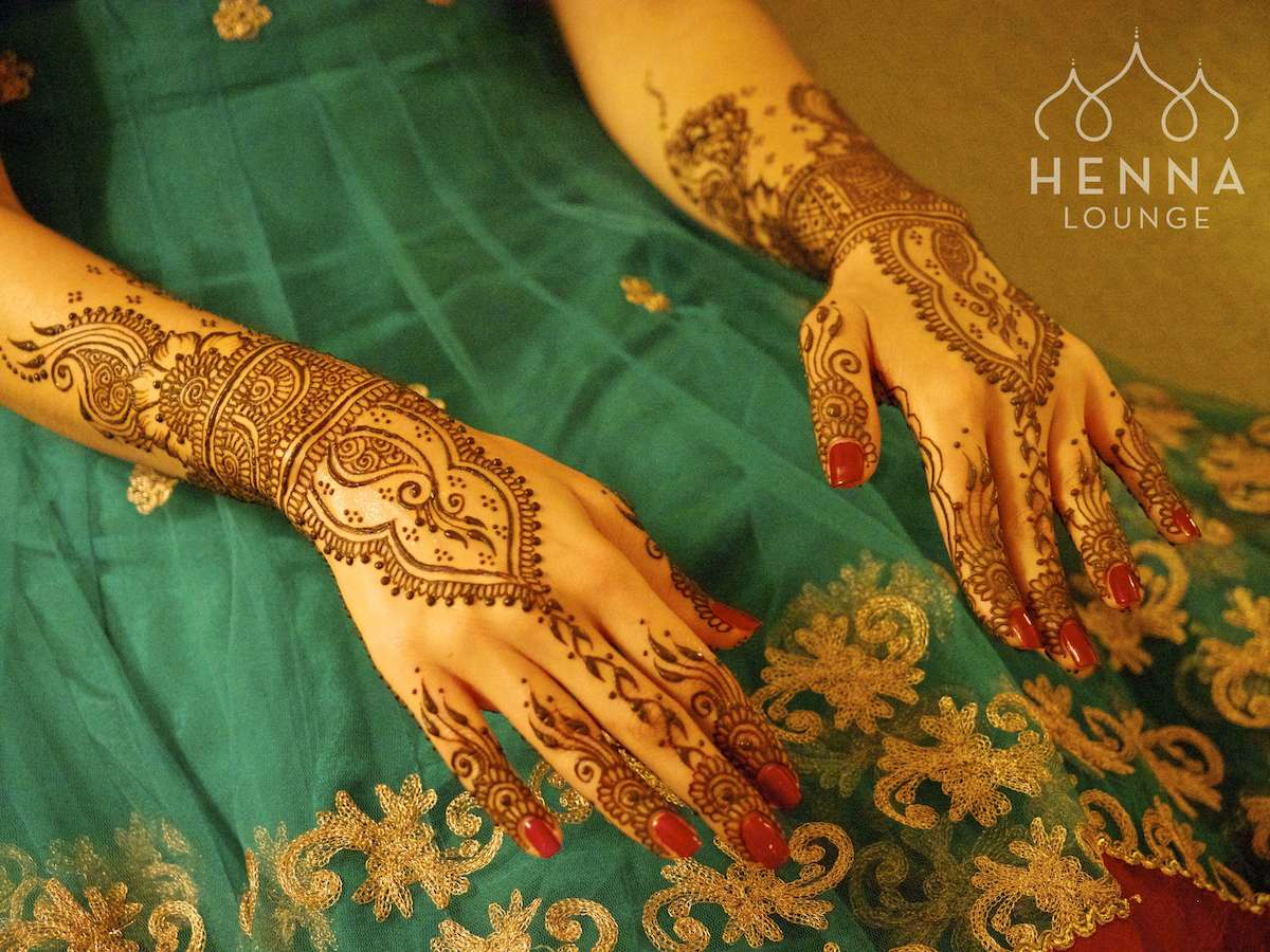 Jewelry-style mehndi for the top of her already graceful hands.