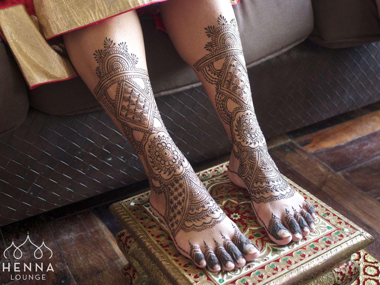 Elaborate mehndi feet