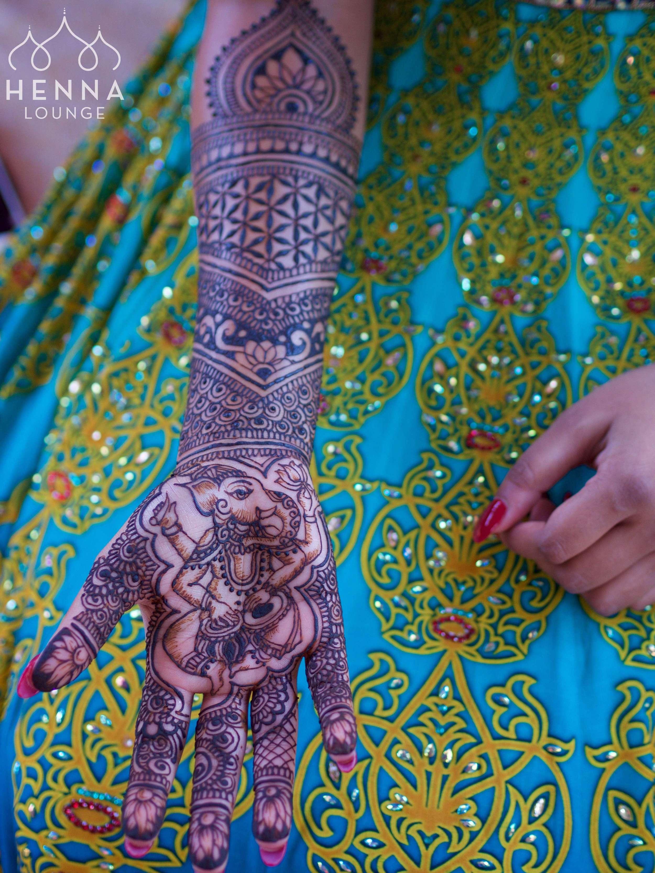 Ganesha with tabla by www.hennalounge.com