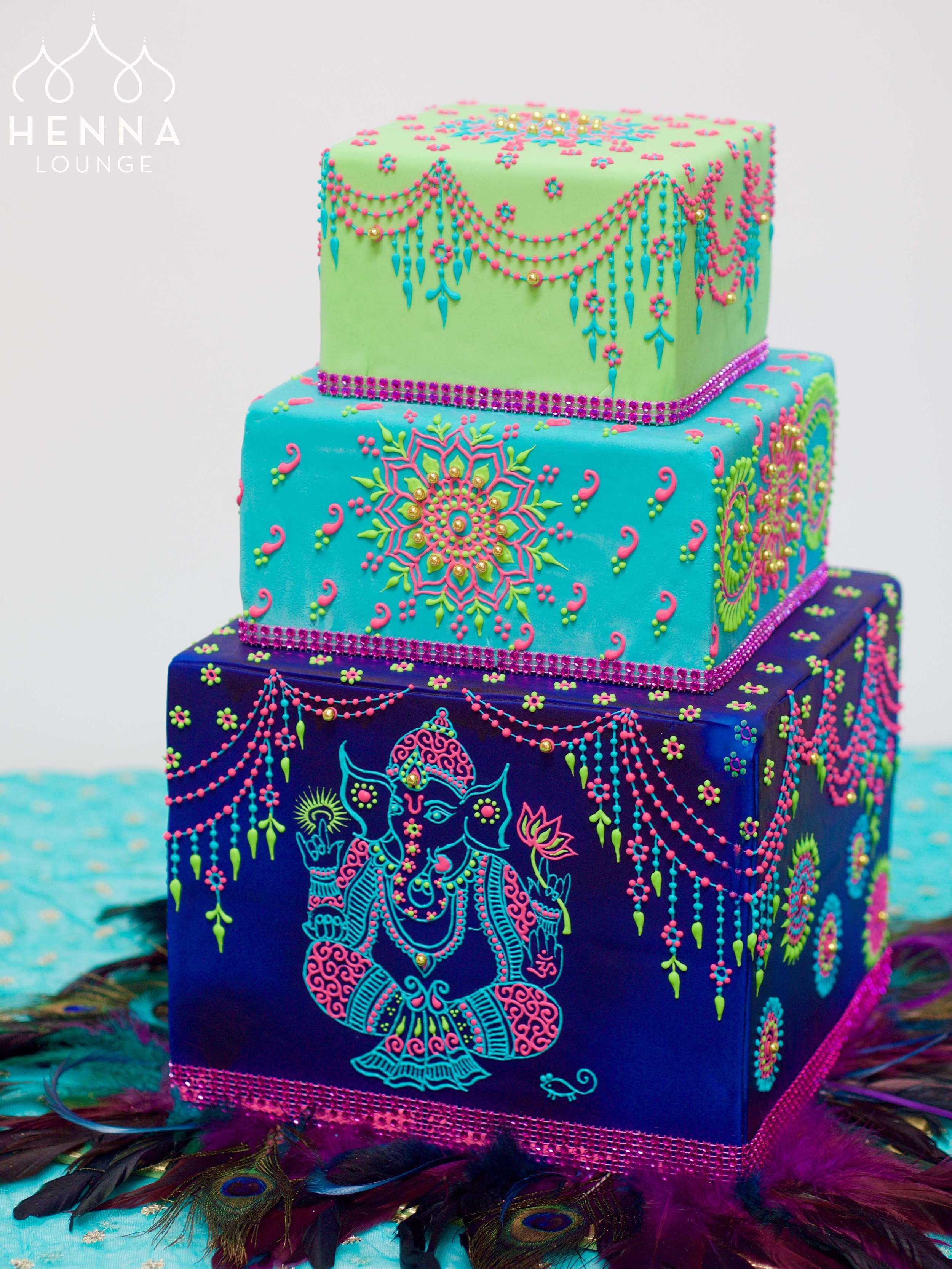 peacock colors wedding cake.jpg
