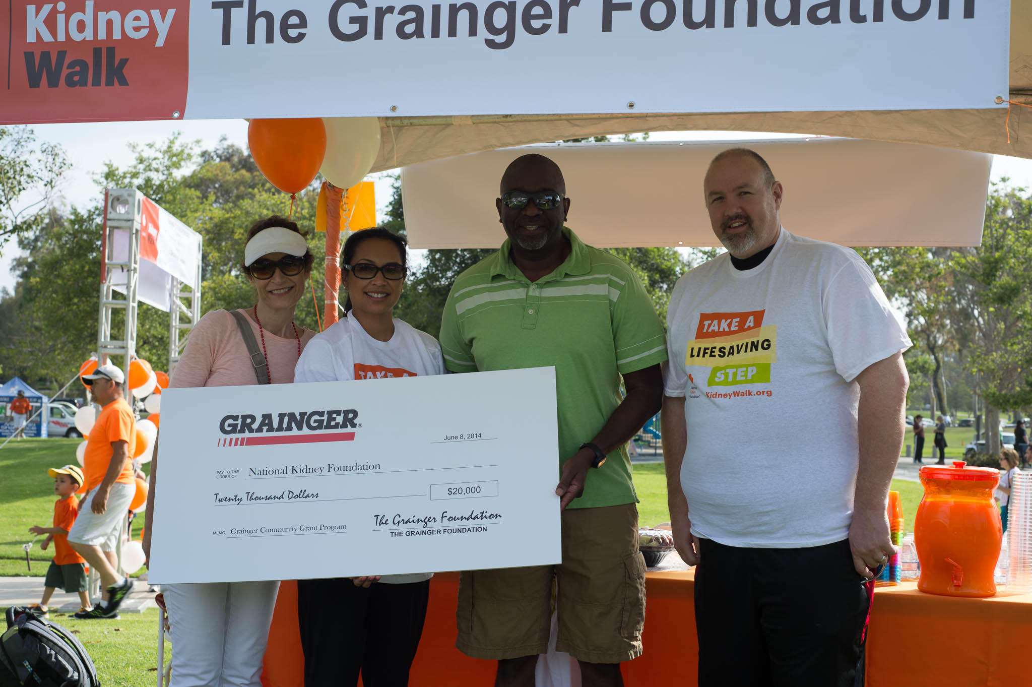 Corporate Sponsors The Grainger Foundation Presenting a Donation to the NKF