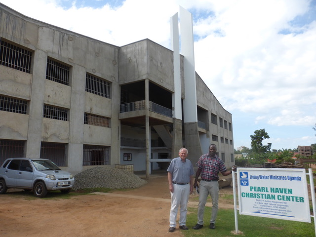 Patrick and Paul in front of Pearl Haven Christian Center, which continues to move towards construction completion.