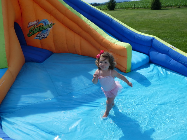 Rachel cools off in the backyard blow-up pool center.