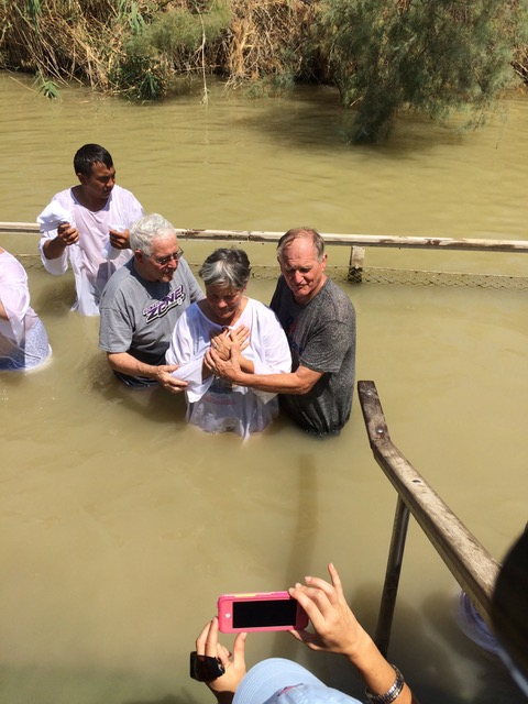 Pastor Paul and Pastor John baptize me in the Jordan River.