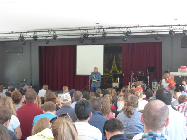 Paul leads a family devotional at the final session for Park Street's Family Camp.