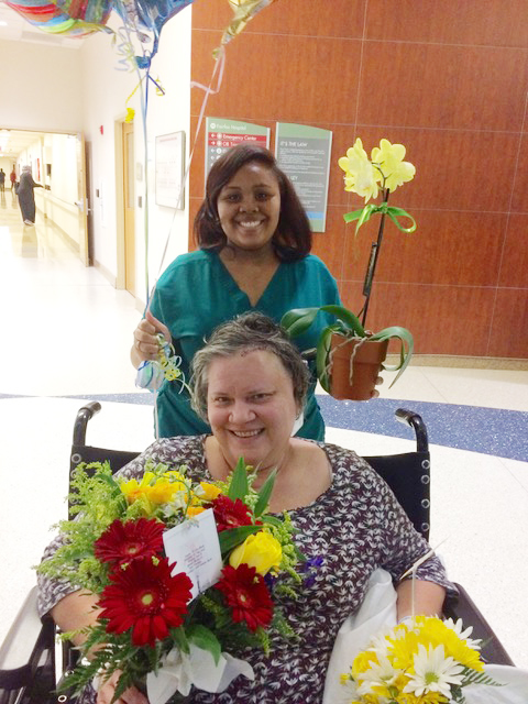 My sister Laura, eleven days after her craniotomy, heads home. SO thankful to even have this photo.
