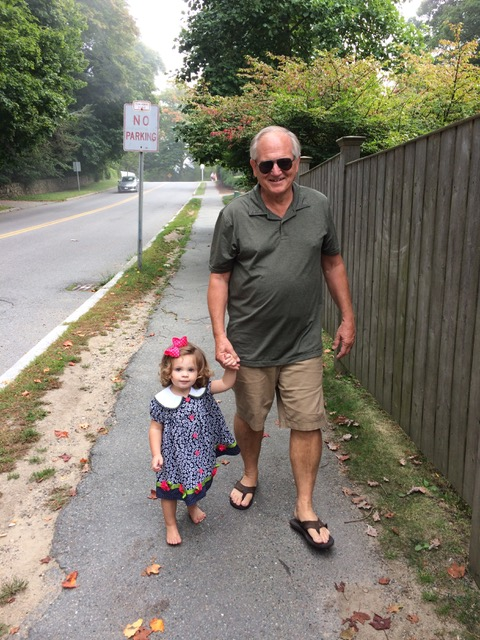 Papa and Rachel walk back to the car from the beach. Not sure when her shoes came off, but she enjoyed the barefoot walk.