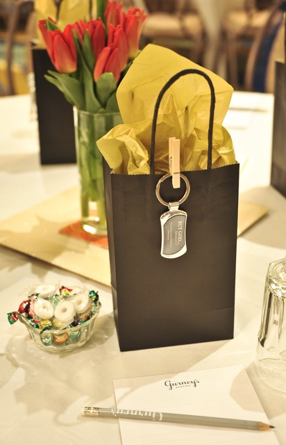 """The """"goodie bags"""" and vases of spring-fresh red tulips created an ambience of thoughtful consideration for each attendee."""