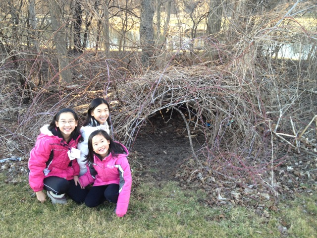 Jessica, Leilani, and Jasmine show us a fort they built in their spacious back yard.