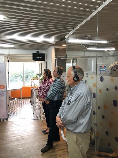 . . . and Paul, Doug, and Julie listen through simultaneous translation headphones.