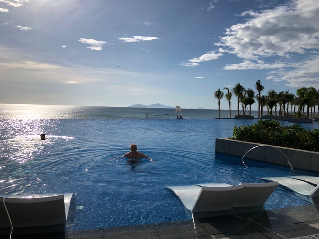 Early morning swim in the infinity pool at the resort in Da Nang, after walking 7 miles on China Beach