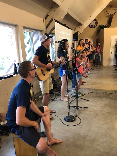 Robert and Jacob Kovacs and Whitney (Jacob's fiancée) teach the memory verse song at family camp.