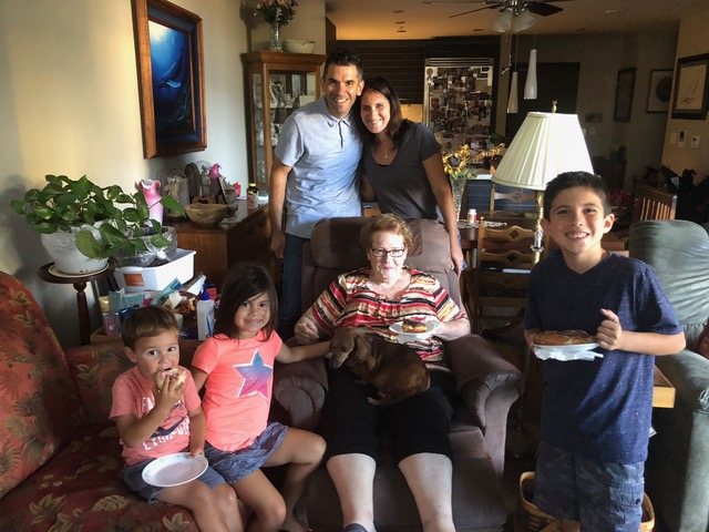 The Garcias arrived bearing doughnuts for their Great-Grandma Essie.