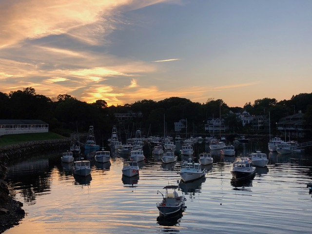 Sunset over the tranquil harbor . . .