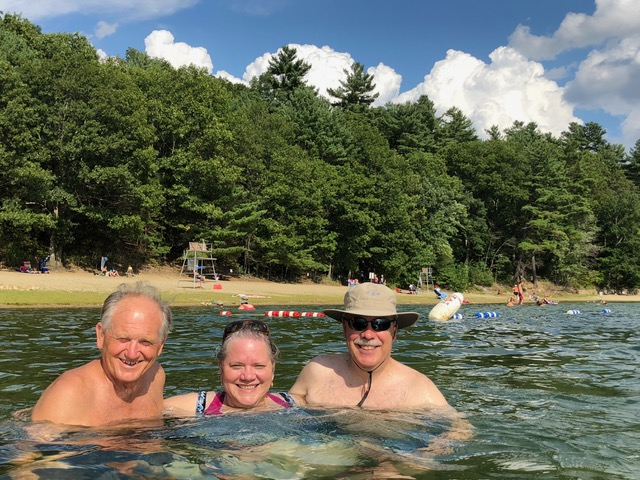 Paul, Laura, and David enjoy the warm water of Walden Pond.