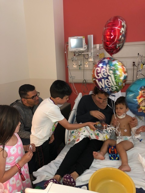 The next day, though, a hospital visit was in order and Micah was very happy to see his siblings.