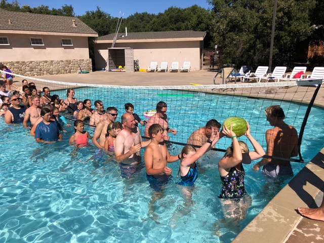 """Pool games were also a huge hit. """"Pass the watermelon over and under"""" evoked fierce competition mitigated with lots of laughter."""