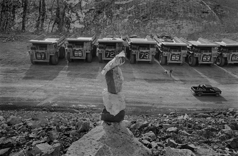 Iktome glyph and 190-ton dump trucks, Sprinkle Creek