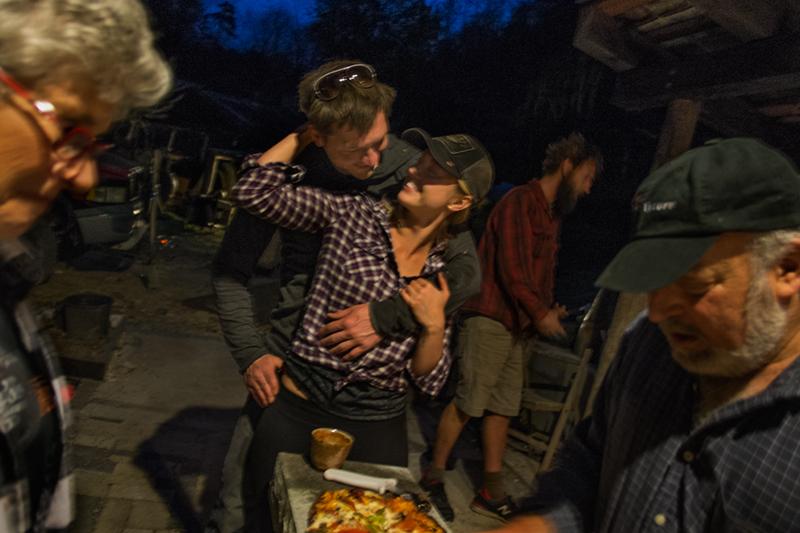 Josh and Lena making pizza at the kiln firing, with Paul Gurewitz, Lower Brush Creek, Madison County, NC 2015