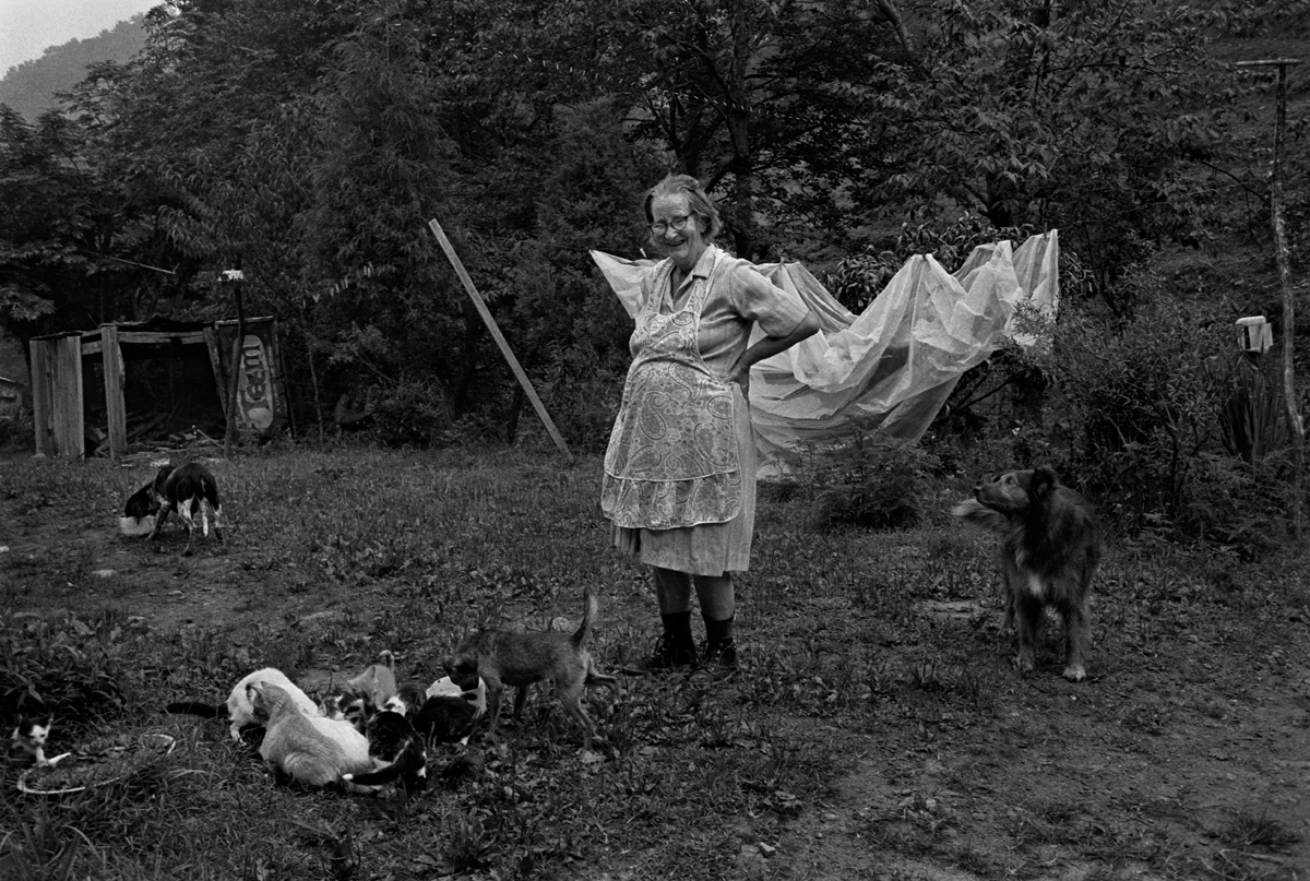Noted balladeer, Dellie Norton, Feeding Her Pets, Sodom, Madison County, NC 1975