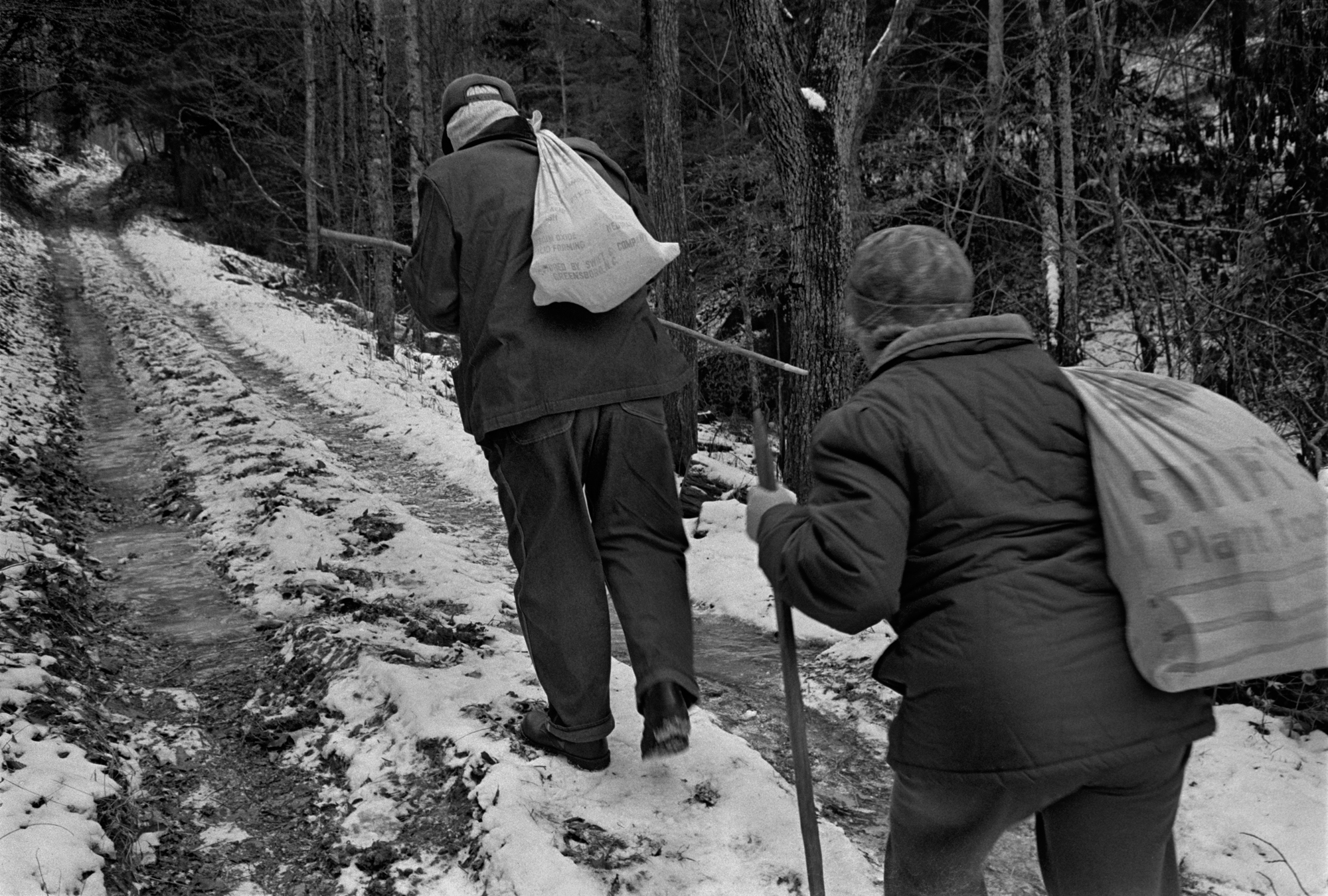 Paul and Grace Henderson Walking groceries to their home in Wilson Cove, Big Pine, Madison County, NC 1990.