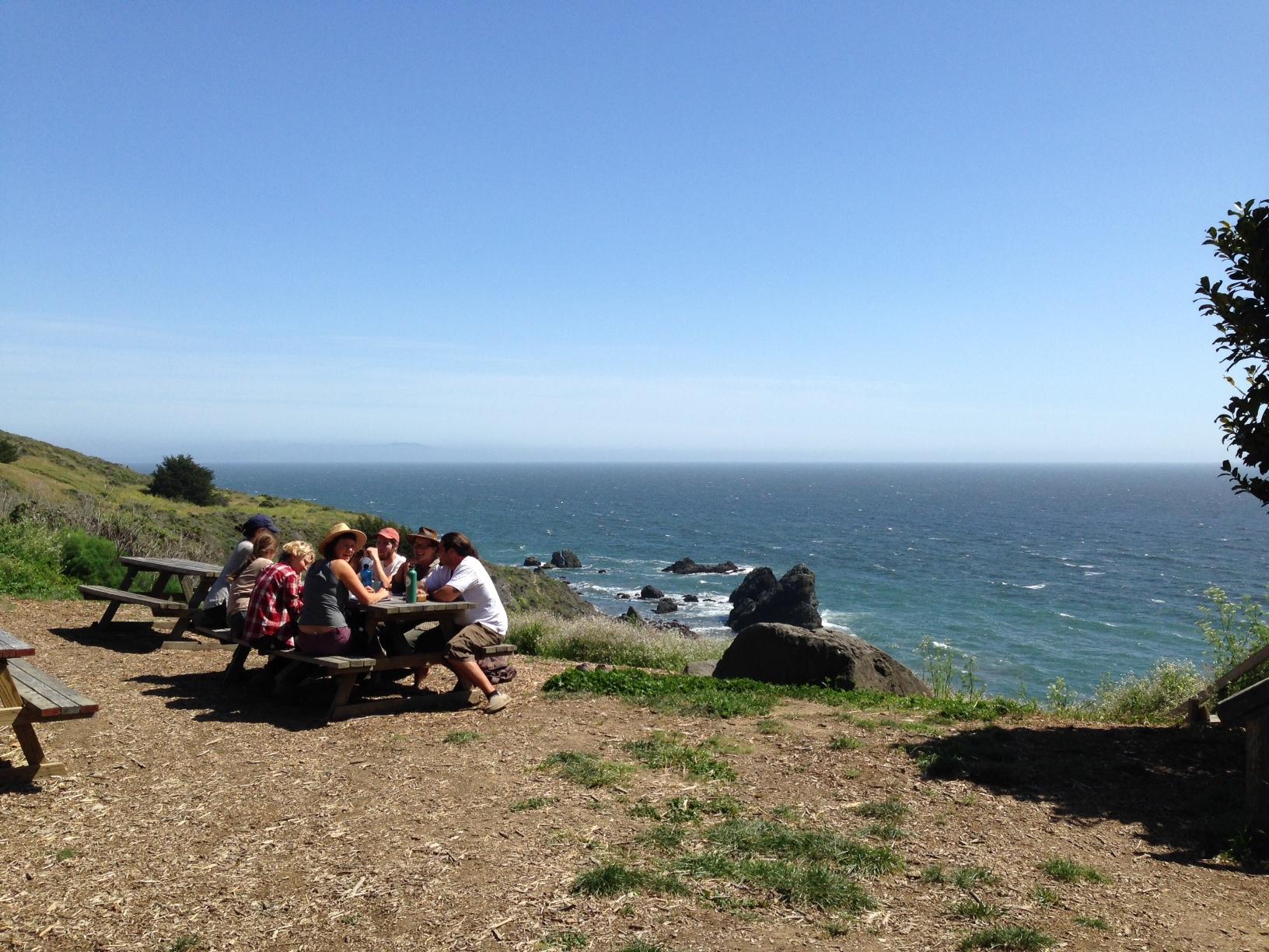 Team meeting overlooking the ocean.