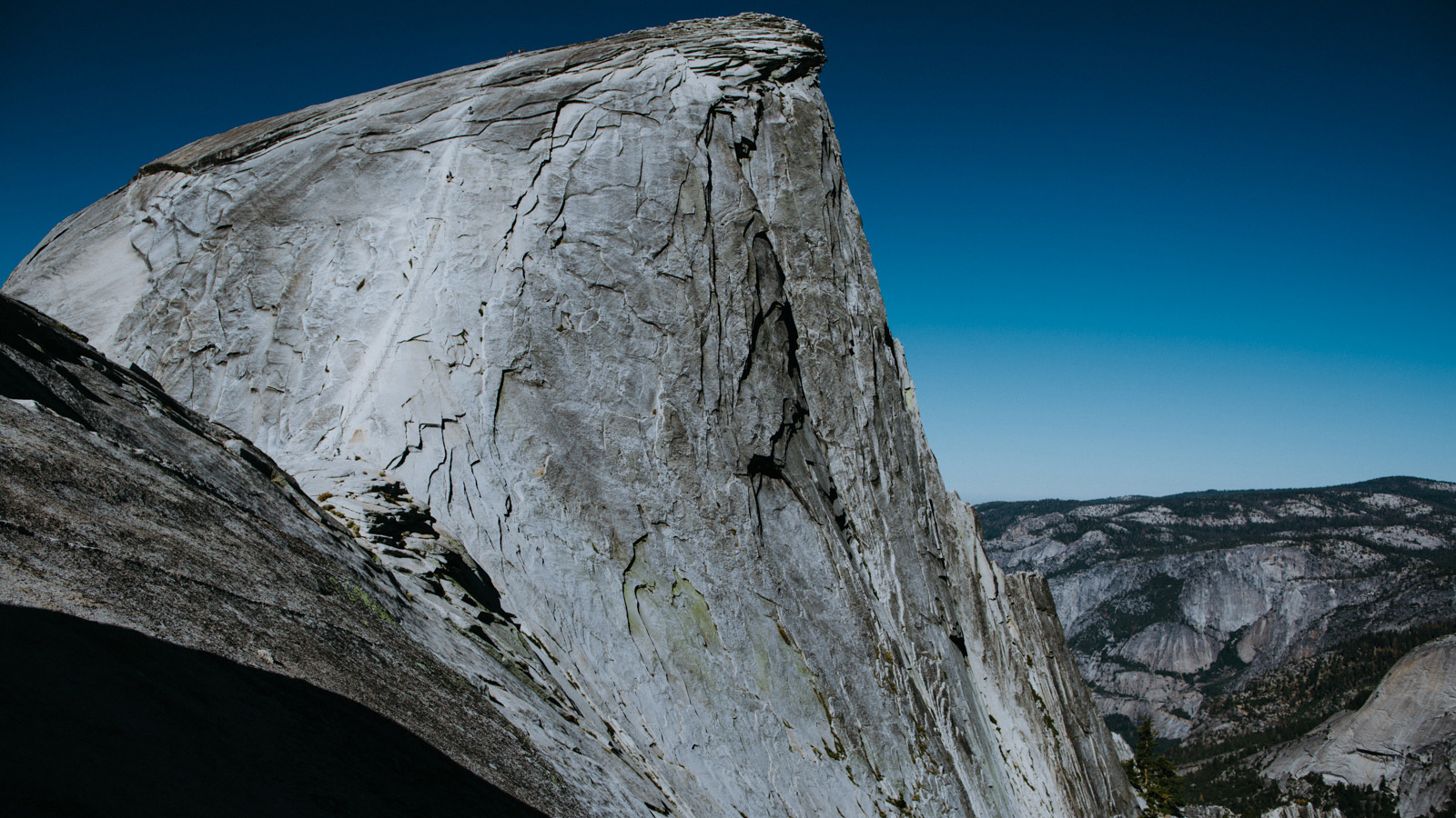 A couple of days later, an early rise and a brisk morning hike brings us to the base of Yosemite's iconic Half Dome. Some of the first people we have seen in days are barely visible on the Cable Route heading up the bleached stripe on the east side of the dome.
