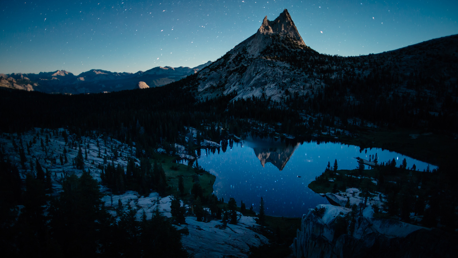 """If our entire time in the Range of Light served as the matinee, then this is certainly the feature. Raked with moonlight, Cathedral sits monumentally above Upper Cathedral Lake and the rest of Tuolumne on this clear summer evening.    John Muir wrote, """"Yonder, to the eastward of our camp grove, stands one of Nature's cathedrals, hewn from the living rock, almost conventional in form, about two thousand feet high, nobly adorned with spires and pinnacles, thrilling under floods of sunshine as if alive like a grovetemple, and well named """"Cathedral Peak."""""""