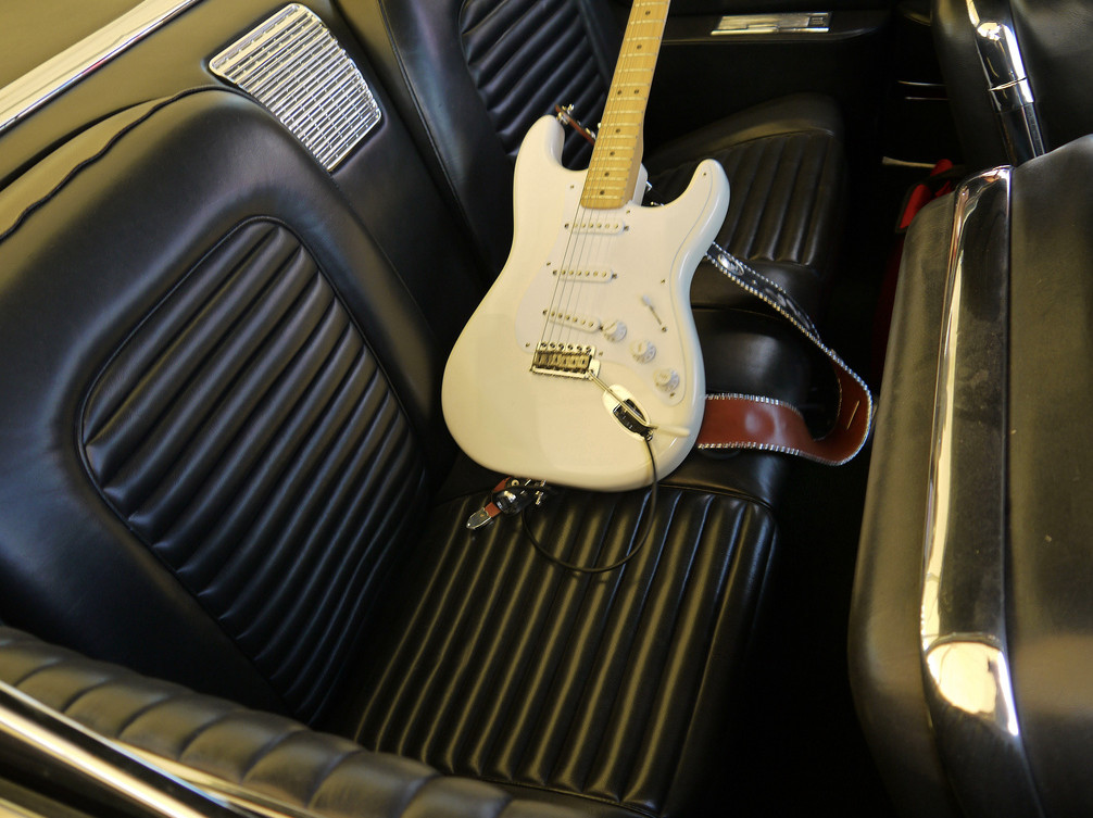Jimmie Vaughan's Fender Stratocaster Guitar in the back seat