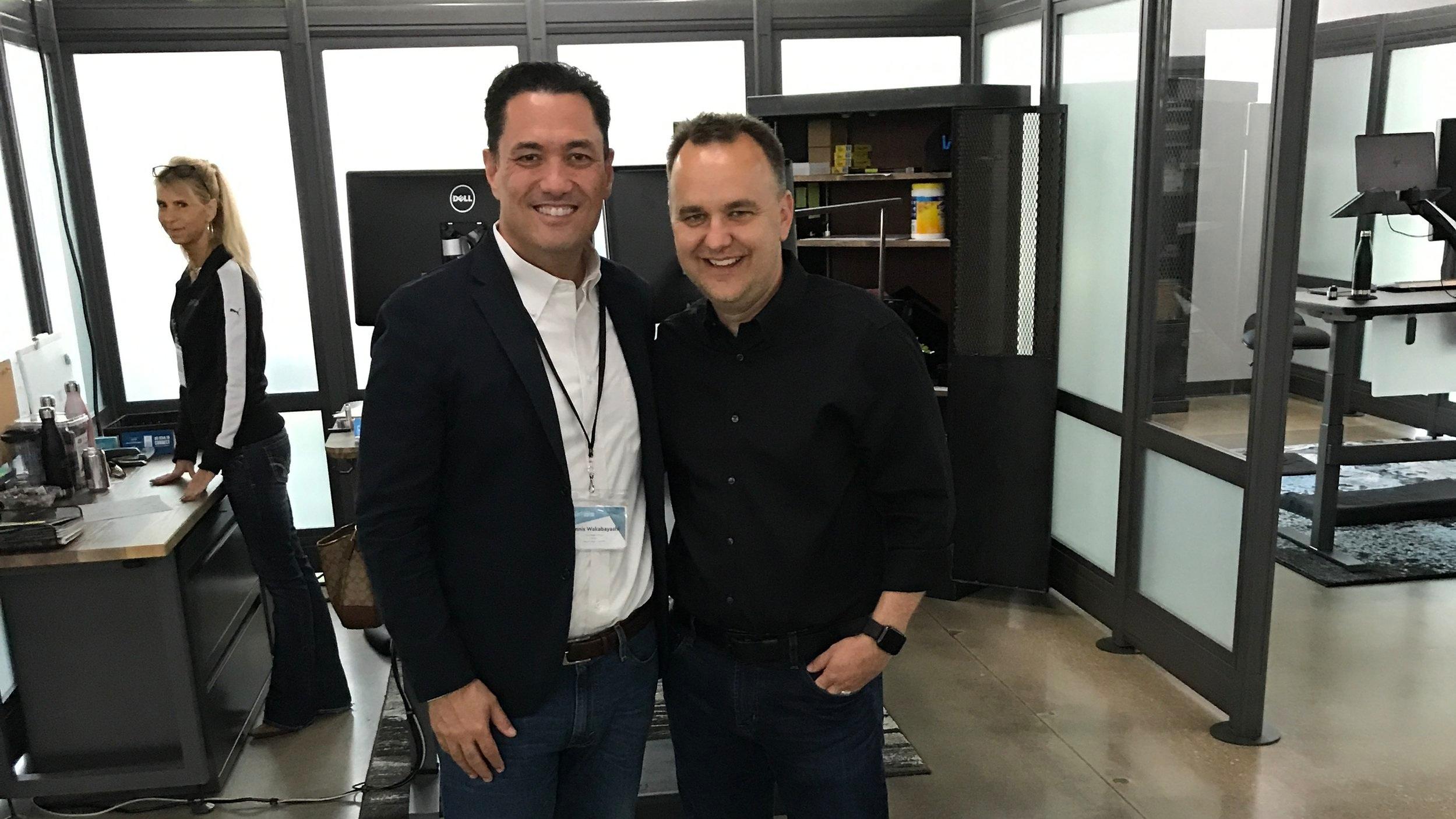 Dennis Wakabayashi on the left and CEO of VARIDESK Jason McCann on the right.